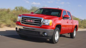2013 GMC Sierra 1500 Crew Cab red driving