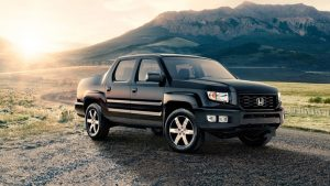 2013 Honda Ridgeline se black at sunset in front of mountain